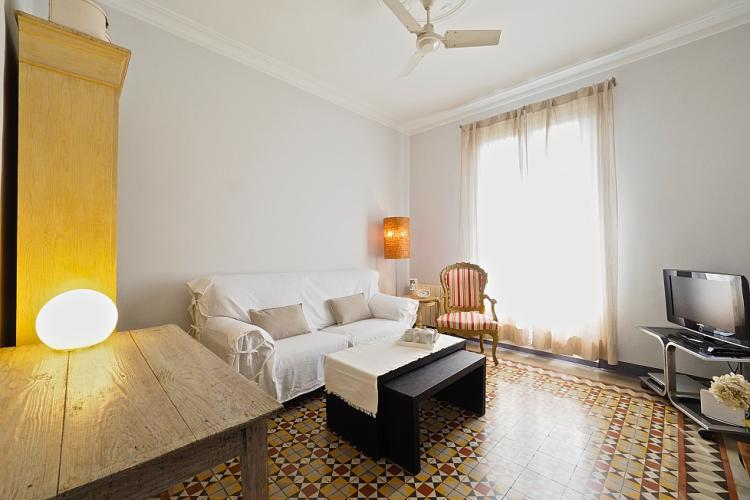 The living room features a large couch on which to relax with your friends or family.