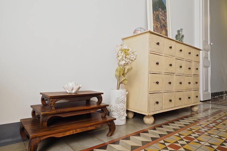 The eclectic collection of furniture gives this space a very unique vintage feel.