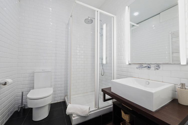 Pristine bathroom with pretty white tiles.