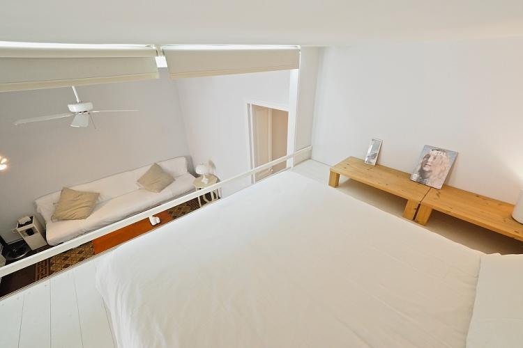The loft is furnished with a double bed and soft lighting to help you relax.