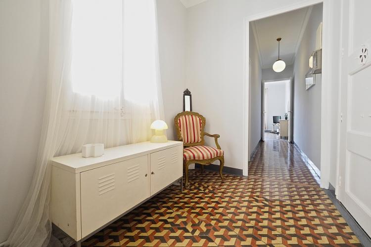 The entry hall of this gorgeous vintage residence features an elegant sofa and long table for you to rest your keys on.