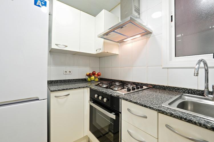 The kitchen is fully equipped with the latest accessories and comes with smooth granite counters.