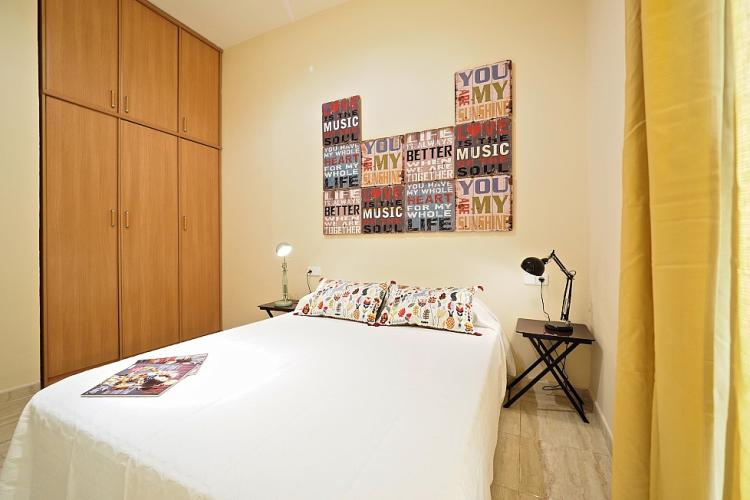 This bedroom also comes with an ample wooden closet in which to store your things during your stay.