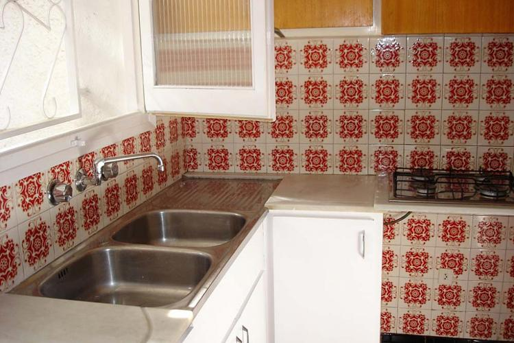 The kitchen comes with double-sinks and the accessories you will need, for your convenience.