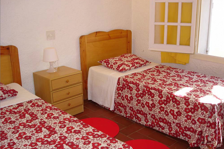The apartment comes with a cute bedroom with two single beds.