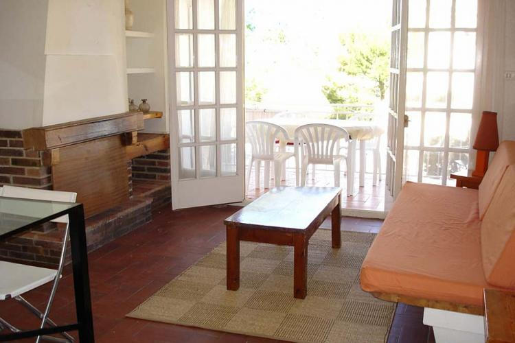 The living room leads out to a sunny terrace, furnished with everything you will need to enjoy a nice meal outside.
