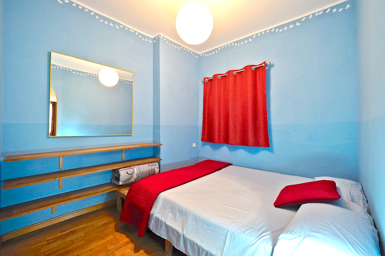A wonderful classic look made so by the baby blue walls, hardwood and the vibrant red color
