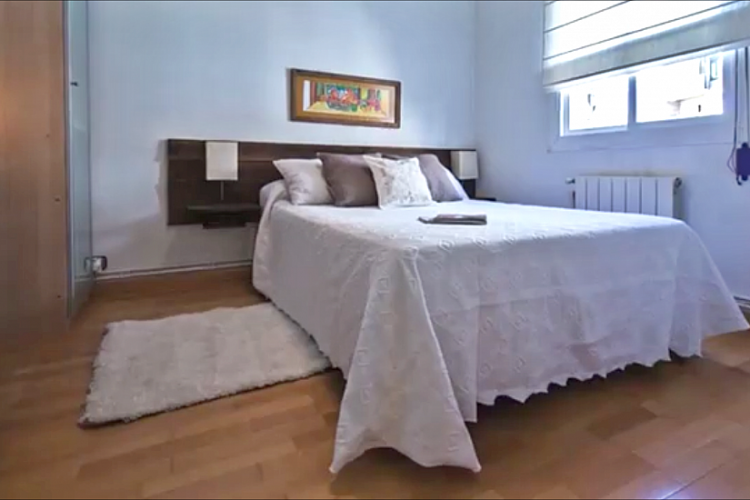 The master bedroom has a double bed, ideal for a couple.