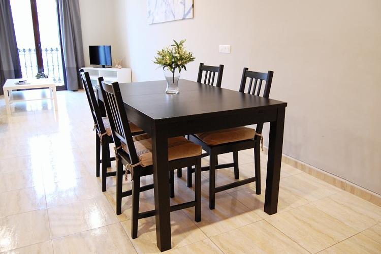 The dining table is for four people