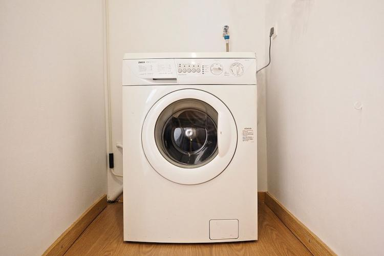 This place comes with a washing machine.