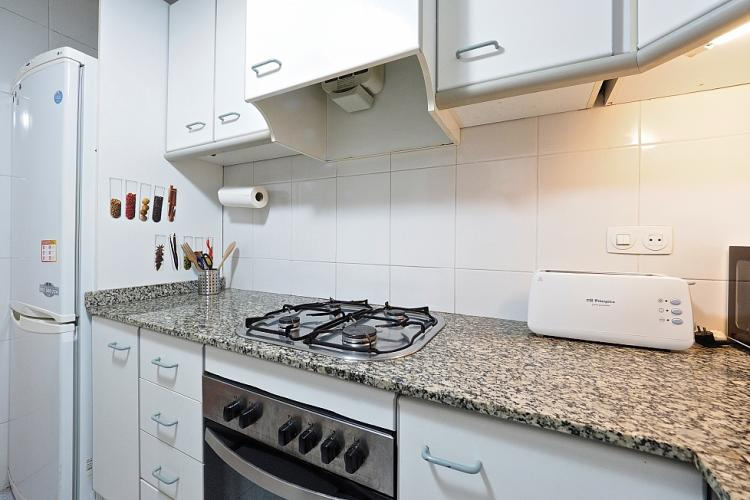 The kitchen has all the necessary utilises that would be needed for cooking and preparing meals.