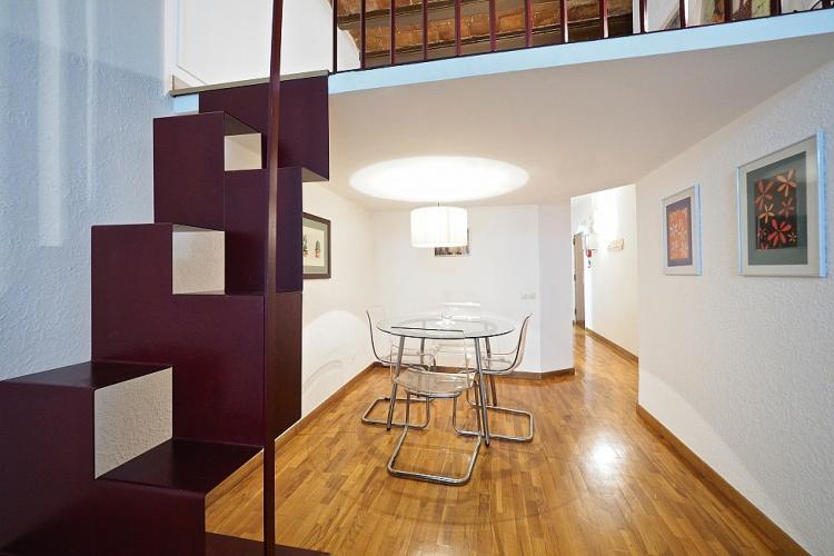The mezzanine can be accessed by a eccentrically designed stairs
