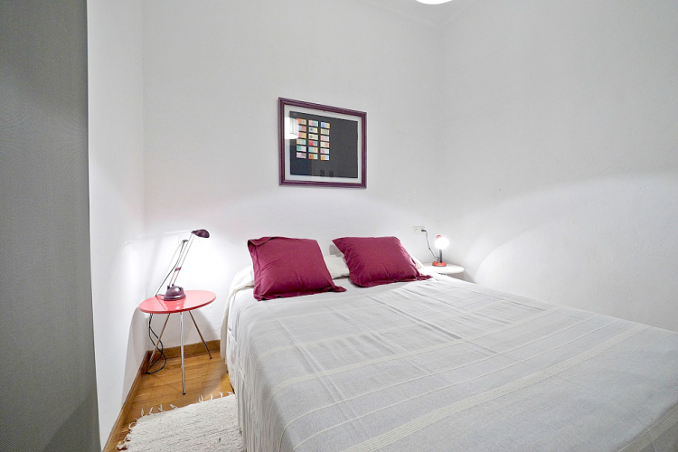The main bedroom is designed with a mix of white and purple.