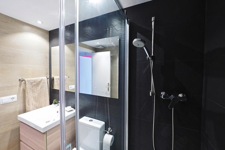 The bathroom is equipped with a full shower.