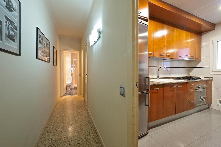 The corridor leads to the bathroom.