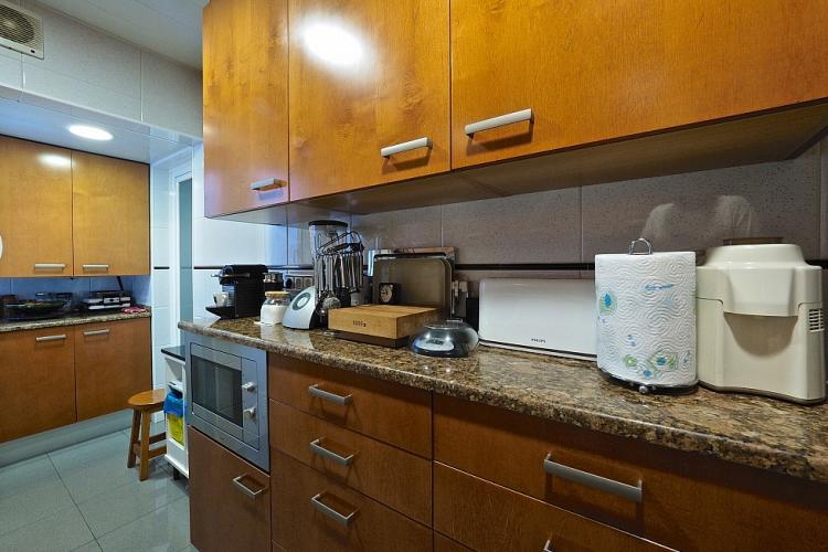 The kitchen features smooth granite countertops and all the accessories you will need to cook.