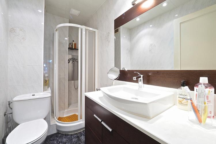 The bathroom is equipped with a shower.