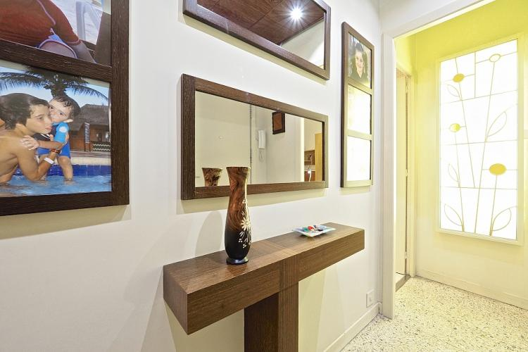 Corridor with family pictures. Lovely home.