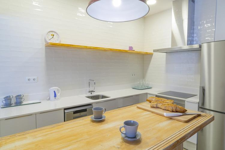 The kitchen is bright and modern