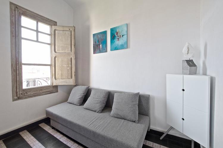 The white decoration and modern art gives the apartment a fresh feeling