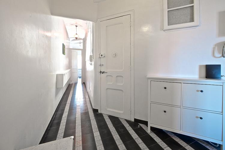 Beautiful black and white stripped corridor which connects the entrance to the rest of the house.