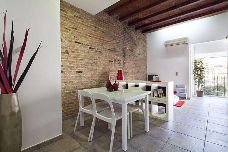 We love the peaceful and quiet dining area, with its rustic exposed brick wall.