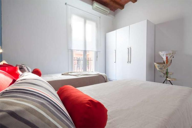 This bright, fresh bedroom has a big window that looks onto the very quiet street.