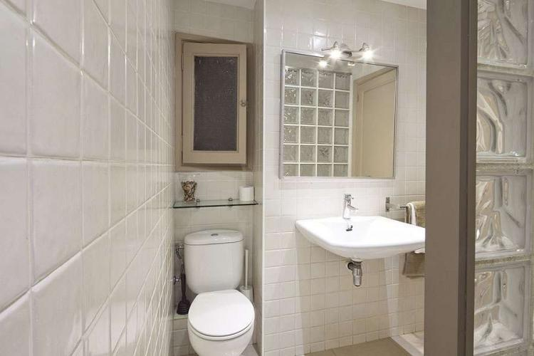 You will also find a bathroom with a shower, decked out in gorgeous polished white tiles.