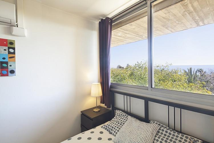 Comfortable double bedroom with big window.