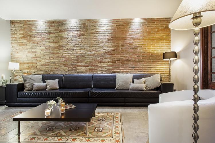 Stylish leather sofa with space for several people.