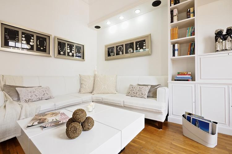 This lovely home features fantastic furniture, such as this stunning white leather sofa
