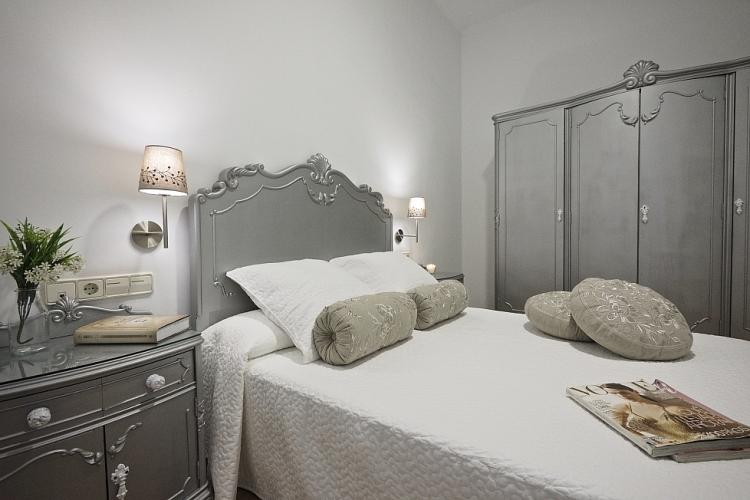 This stunning bedroom feels elegant, yet casual with plenty of storage space available
