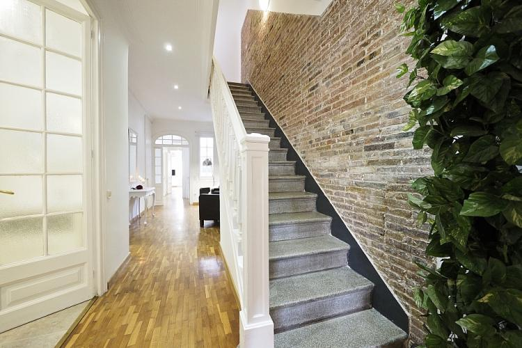 Stunning hardwood floors with an amazing stone staircase.