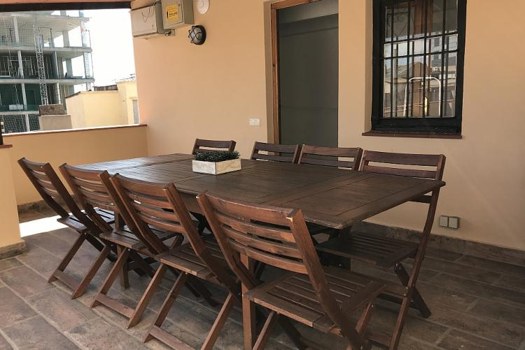 The terrace comes equipped with lounge furniture as well a table with chairs, perfect for lunch outside.