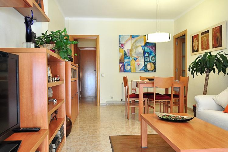 The living room is furnished with nice matching wooden furniture.