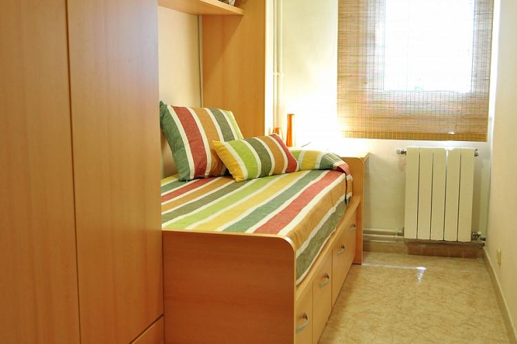 This fantastic bedroom comes with a cozy single bed and a set of drawers and armoire in which to store your things.