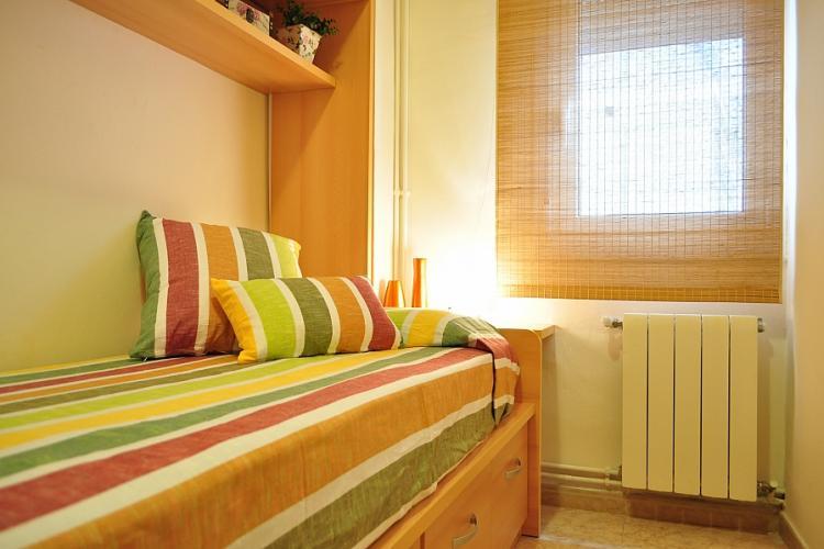 Sunny bedroom in the artistic Gracia neighborhood.