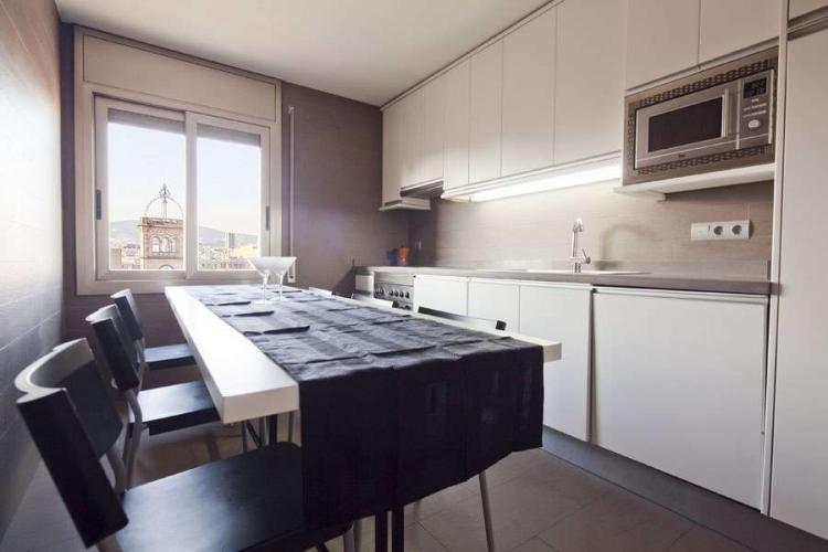 Elegant and fully equipped kitchen perfect for preparing meals throughout your stay. Dining table for up to 8 people.