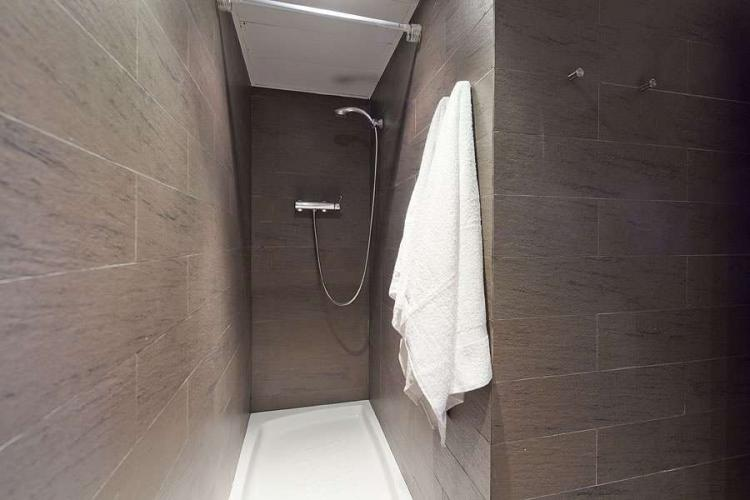 Gorgeous brown and gray bathroom with a shower.