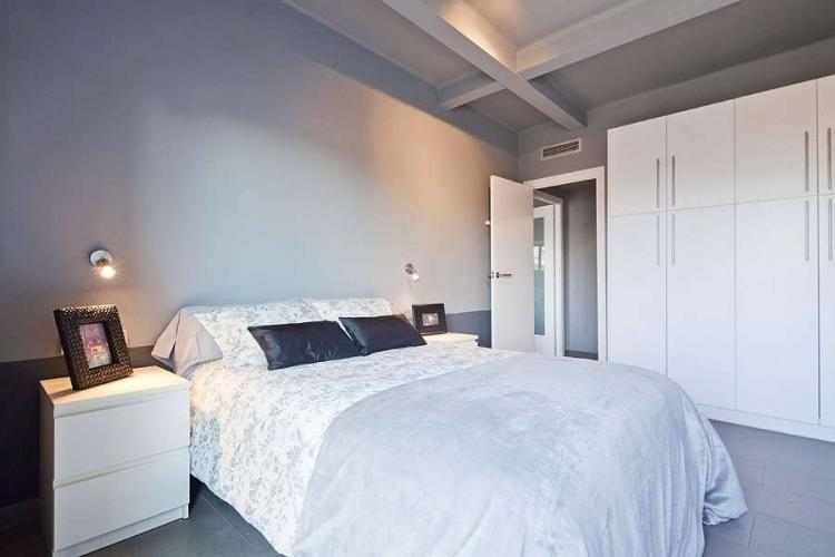 The main bedroom has a double bed and cabinets perfect for storing luggage.