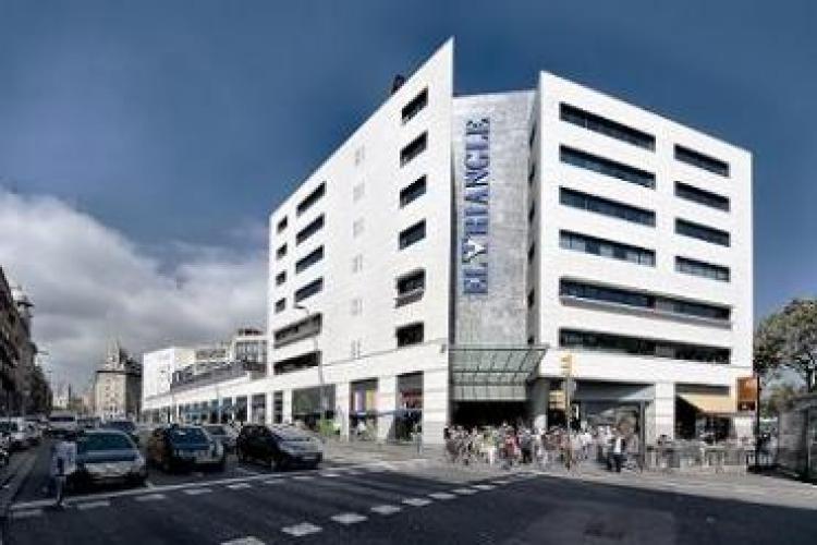 Go shopping at Placa Catalunya.