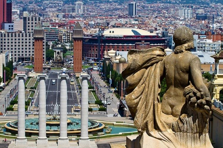 Visit Placa d'Espanya a major tourist site in the center of Barcelona.