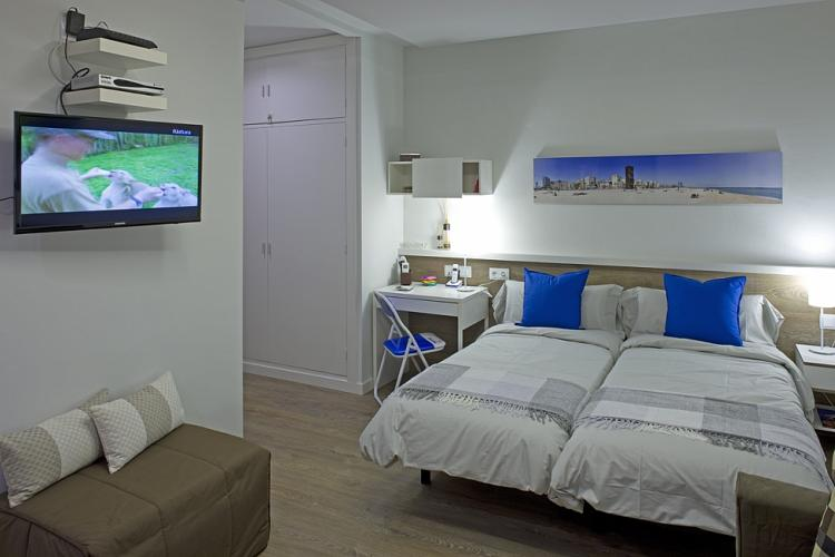 The TV can be adapted for the view from the bedroom area or kitchen area