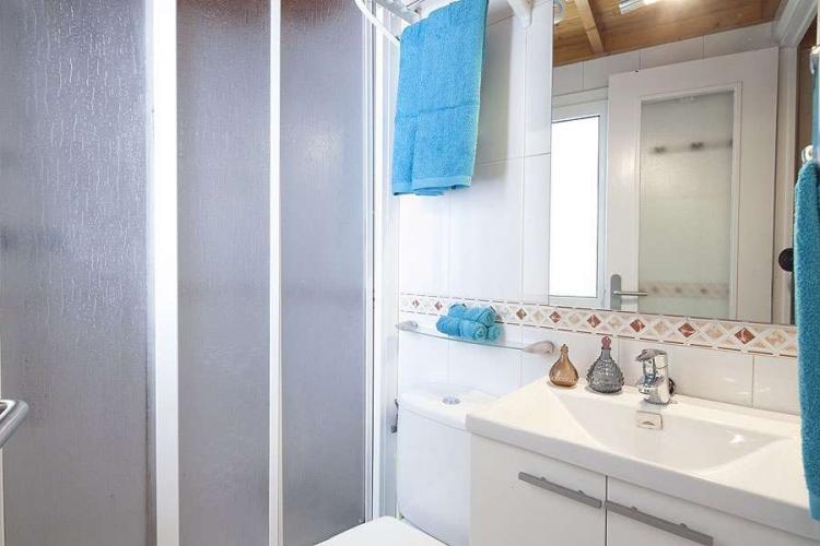 The bathroom has a shower.