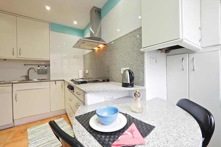 You are sure to enjoy this pleasant breakfast nook beside the kitchen.