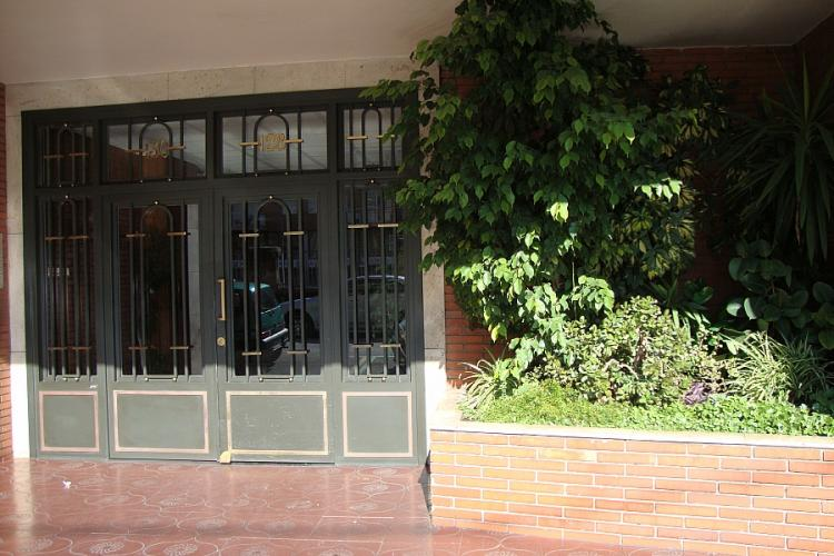 The entrance to the building is secured by iron doors.