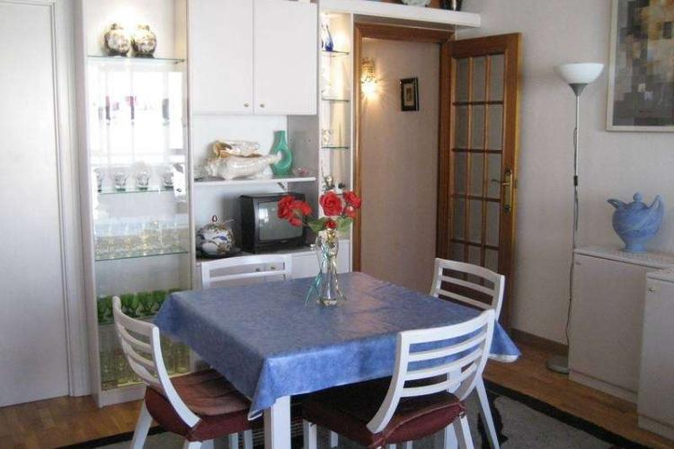 The kitchen has a dining table perfect for enjoying meals