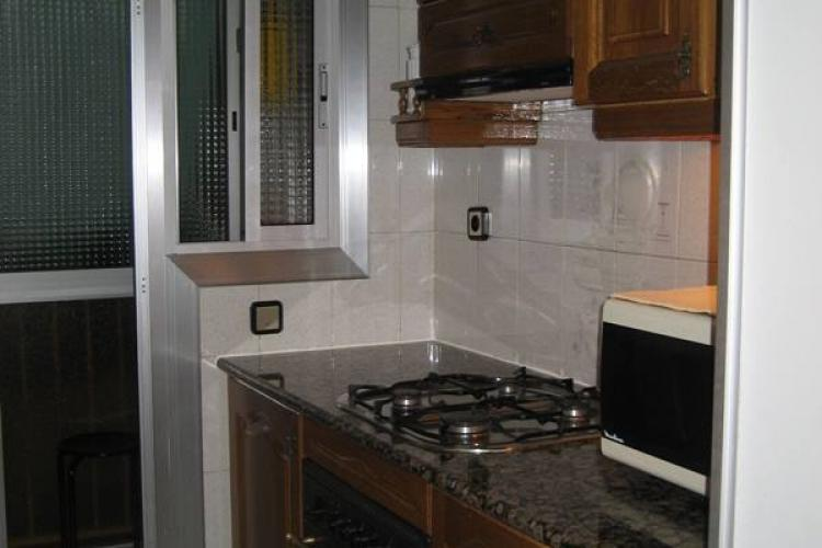 The fully equipped kitchen comes with a gas stove to cook hot food with.