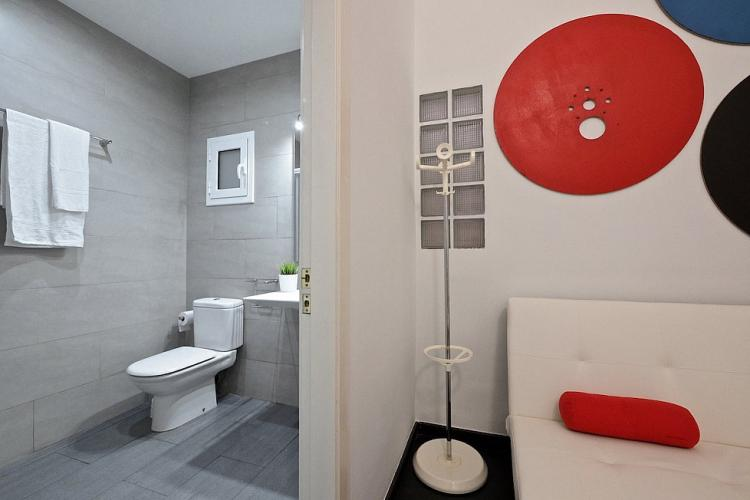 Decorated hall with artistic drawings and modern bathroom