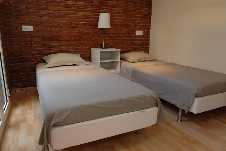 Double bed room with a esthetic brickwall